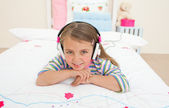 Cute little gril listening to music — Stock Photo