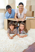 Jolly family playing with boxes — Stock Photo