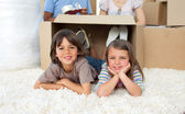 Adorable siblings playing with boxes — Stock Photo