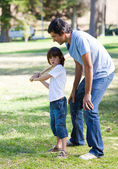 Happy father teaching baseball to his son — Stock Photo