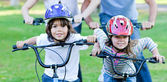 Jolly children riding a bike — Stock Photo