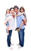 Jolly parents giving their children a piggyback ride — Stock Photo