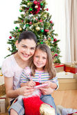 Mother and daughter at home at Christmas — Stock Photo
