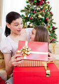 Mother and daughter at home at Christmas time — Stock Photo