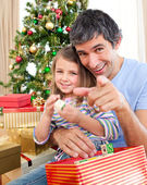 Father and little girl playing with Christmas presents — Stock Photo