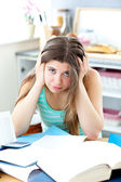 Depressed student doing her homework on a desk — Stock Photo