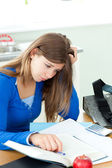 Stressed student doing her homework on a desk — Stock Photo