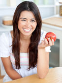 Attractive young woman holding a red an apple — Stock Photo