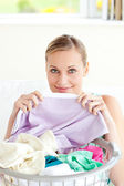 Cute young woman doing housework — Stock Photo