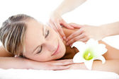 Portrait of a relaxed woman having a massage — Stock Photo