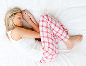 Pretty woman sleeping on her bed at home — Stock Photo