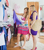 Bright women choosing clothes together — Stock Photo