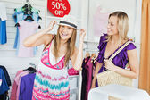 Jolly women choosing clothes together — Stock Photo