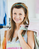 Happy woman choosing clothes — Foto Stock