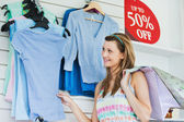 Delighted woman choosing clothes — Stockfoto