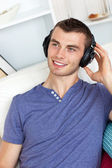 Good-looking man listening to music — Stock Photo