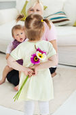 Sweet woman get surprise by her daughters — Stock Photo