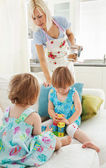 Woman playing with her daughters — Stock Photo