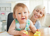 Glad mother playing with her daughter — Stock Photo