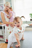 Attractive woman playing with her daughters — Stock Photo
