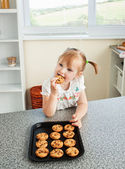 Cute girl eating cookie — Stock Photo