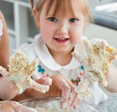 Sweet child baking cookies with hands — Stok fotoğraf