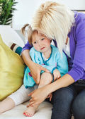Sick sad child lying on couch — Stock Photo