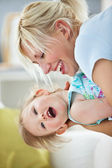 Simper mother playing with her daughter — Stock Photo