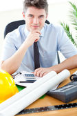 Young businessman in front of his desk — Stock Photo