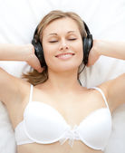 Relaxed woman listening to music — Stock Photo