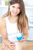 Nice girl using cream — Stock Photo