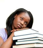 学生靠在一堆书上 — 图库照片