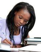 Afro-american woman studying at home — Stock Photo