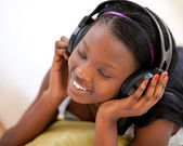 Kind woman listening to music — Stock fotografie