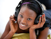 Smiling woman listening to music — Stock Photo