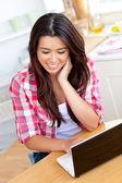 Smiling woman using laptop — Stock Photo