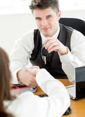 Young businessman shaking hands — Stock Photo