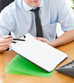 Businessman holding document — Stock Photo