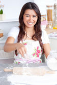 Captivating asian woman baking in her kitchen — Stock Photo