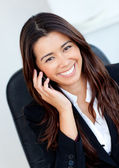 Jolly asian businesswoman talking on phone — Stock Photo