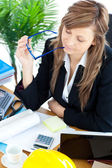 Busy businesswoman sitting a her desk — Stock Photo