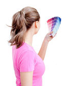 Blond young woman choosing colours in her living-room — Stock Photo