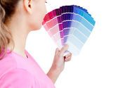 Beautiful young woman choosing colours in her living-room — Stock Photo