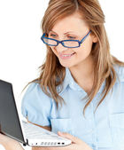 Ambitious businesswoman standing using her laptop — Stock Photo
