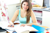 Captivating brunette student doing her homework — Stock Photo