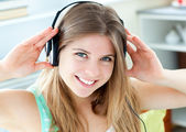 Jolly caucasian woman listen to music with headphones — Stock Photo