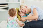 Woman is hugging her daughter — Stock Photo