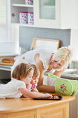 Blond mother having fun with her daughters — Stock Photo