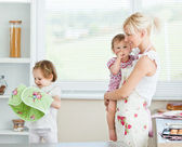 Mother having fun with her daughters — Stock Photo