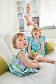 Blond mother having fun with her young daughters — Stock Photo